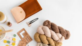 An image of a handful of yarn supplies and bits & bobs